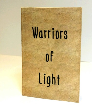 """Warriors of Light   Cover, origami folded book, featuring photographs of original artwork and poetry, digital print   4 1/8"""" x 2 3/4""""   2016"""